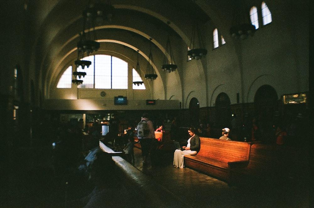 woman sitting on church pew