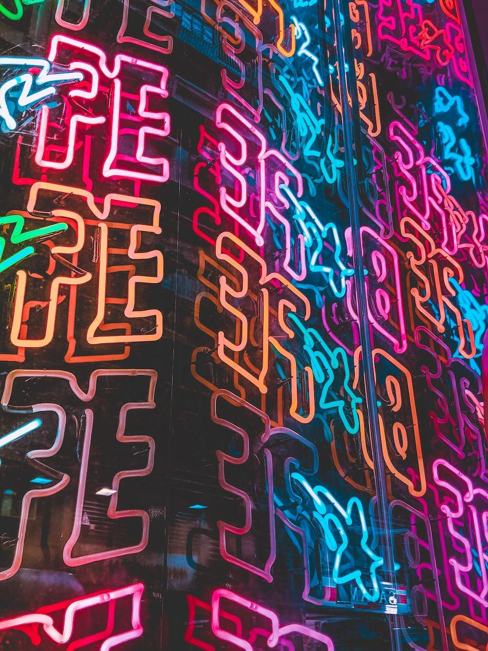 orange, pink, and blue neon lights decoration