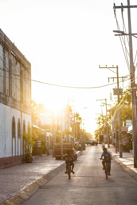 two boys riding on bike