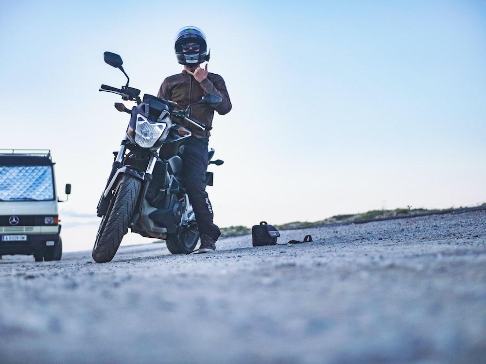 man riding motorcycle during daytime