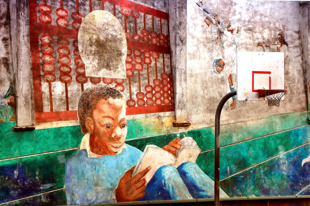 man reading book painting