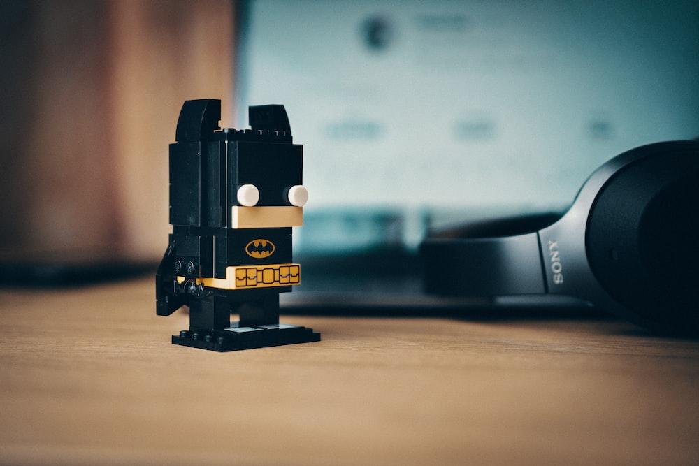 Lego Batman figurine on wooden surface