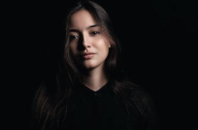 woman in black V-neck shirt