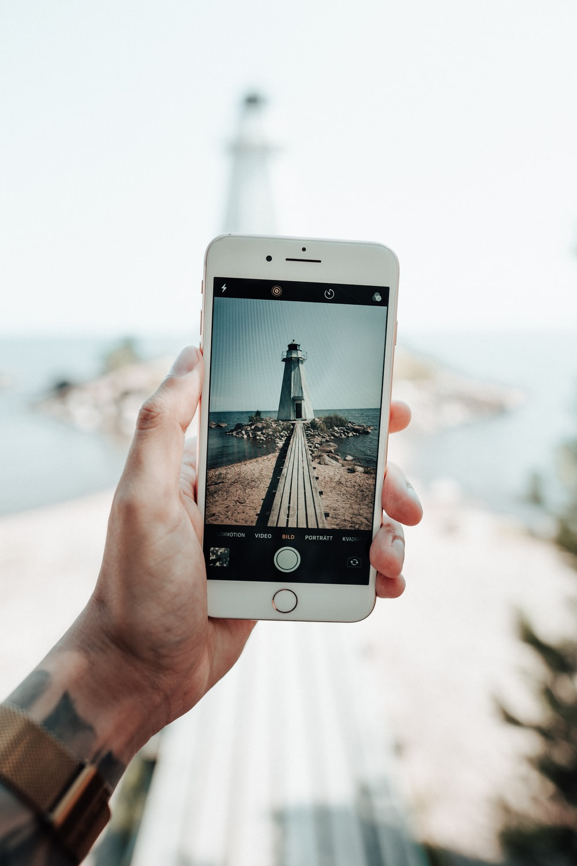 white lighthouse through phone