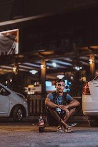 man sitting on skateboard