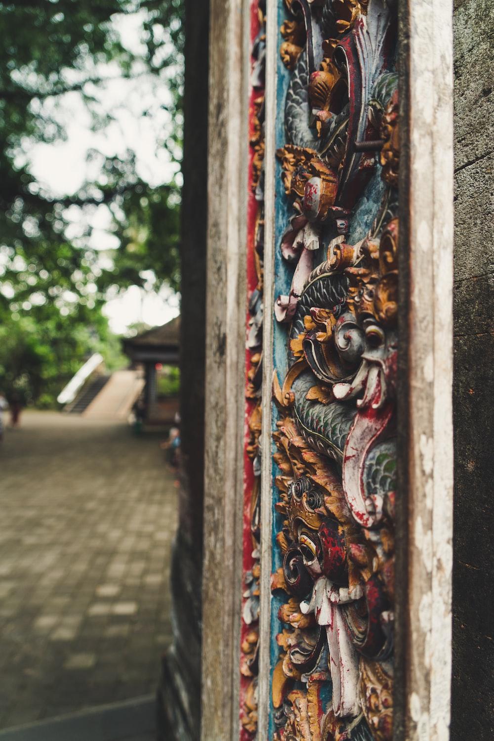 multicolored wood carving door