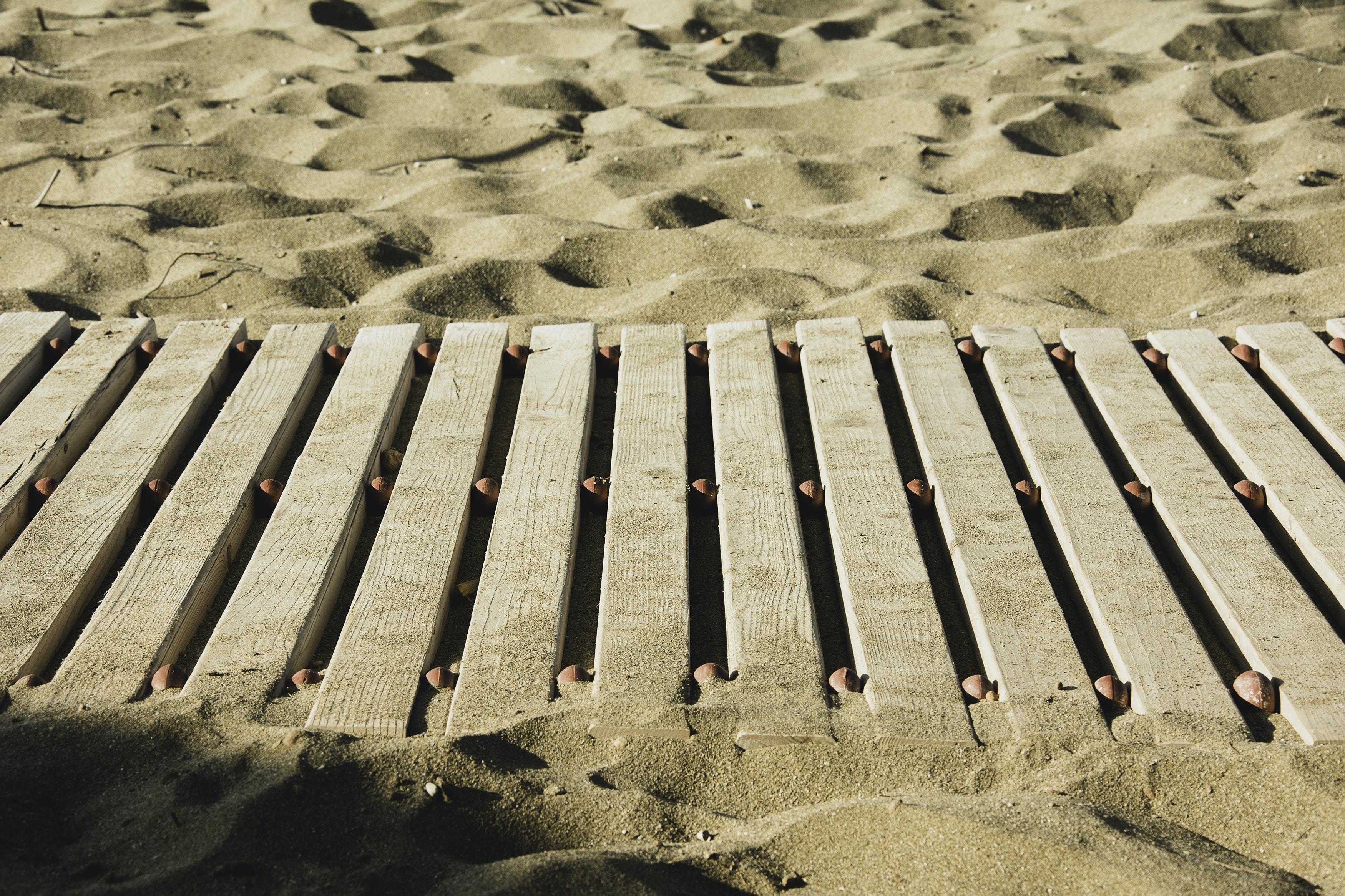 brown wood pallet on sand