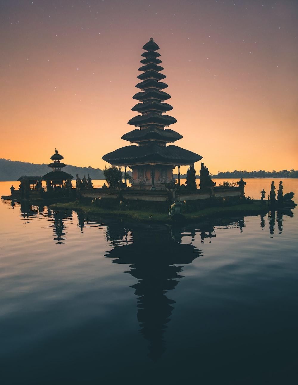 temple in between body of water
