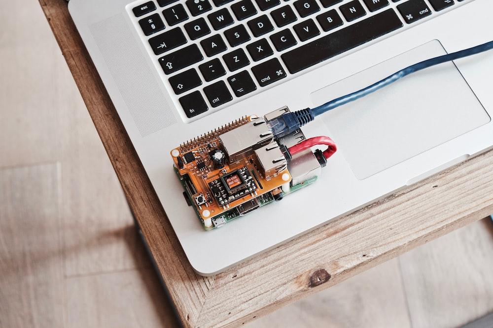 brown circuit board on laptop