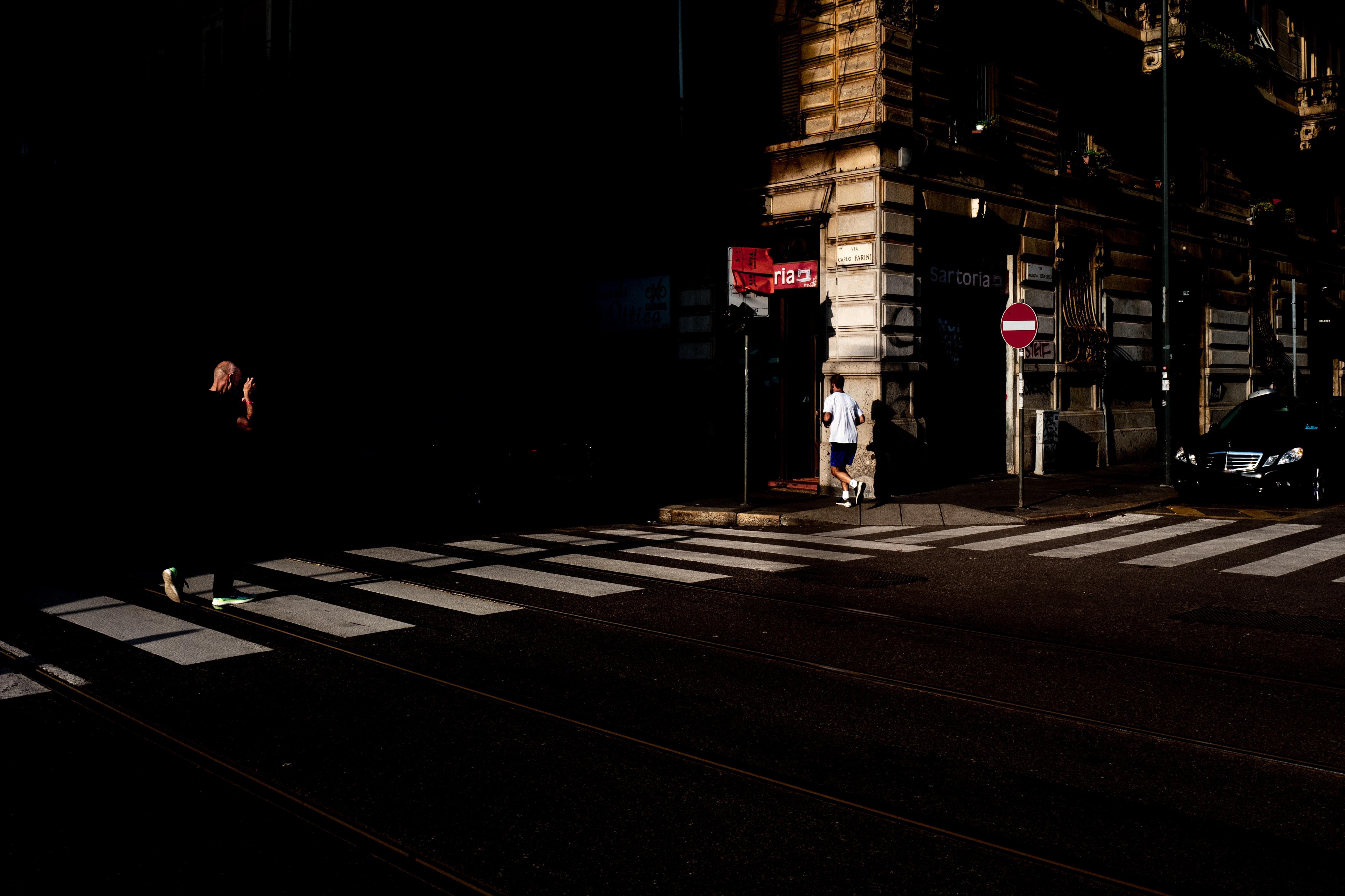 man walking near pedestrian lane