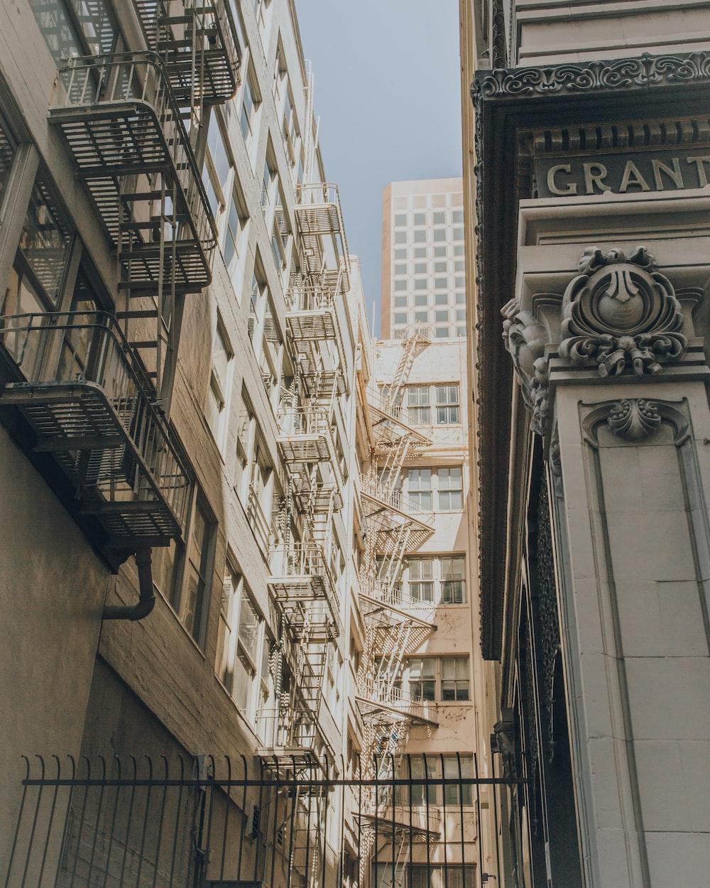 person taking photo of white concrete buildings