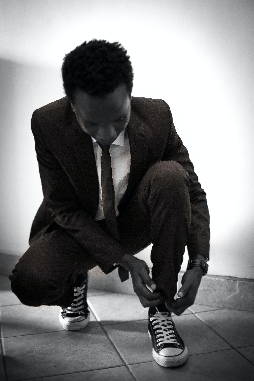 man tying his shoe lace