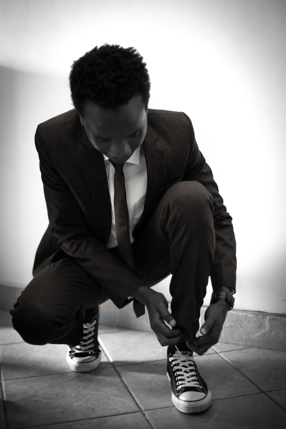 man tying his shoe lace