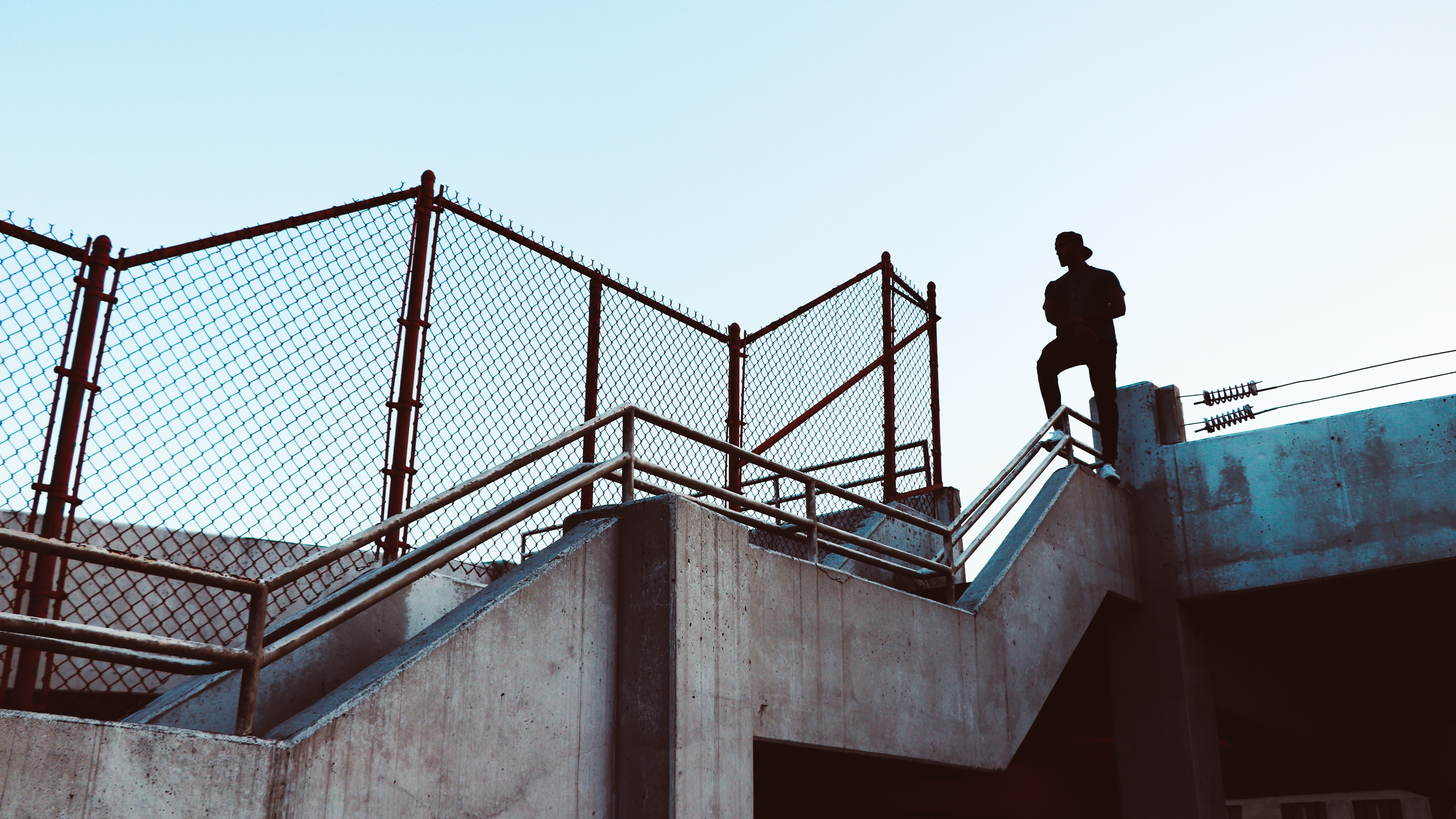 man stand on stair railing