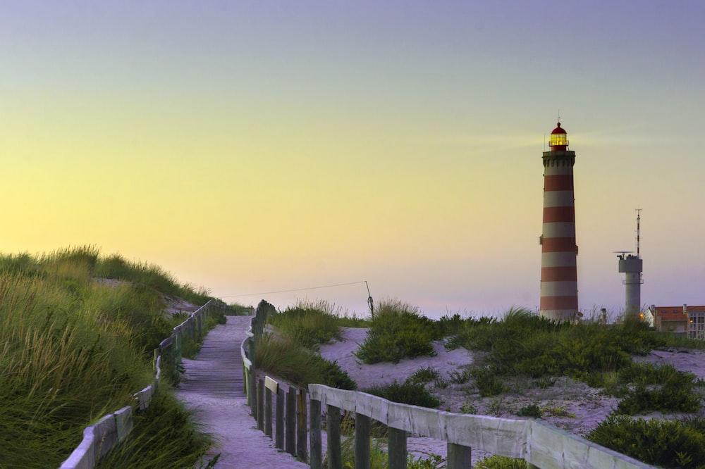 gray pathway near lighthouse