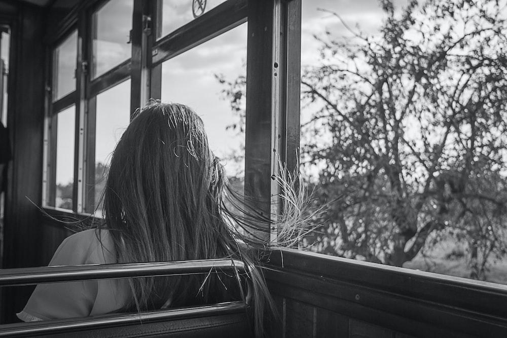 woman sitting beside window