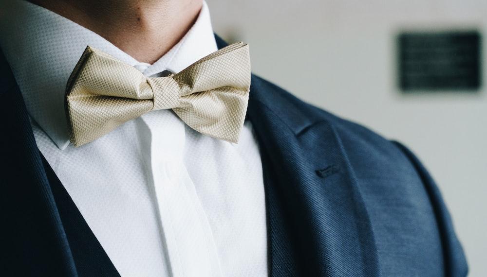 man wearing grey bow tie