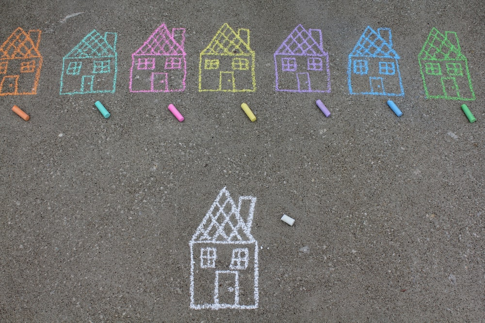 assorted-color house illustration on gray concrete surface