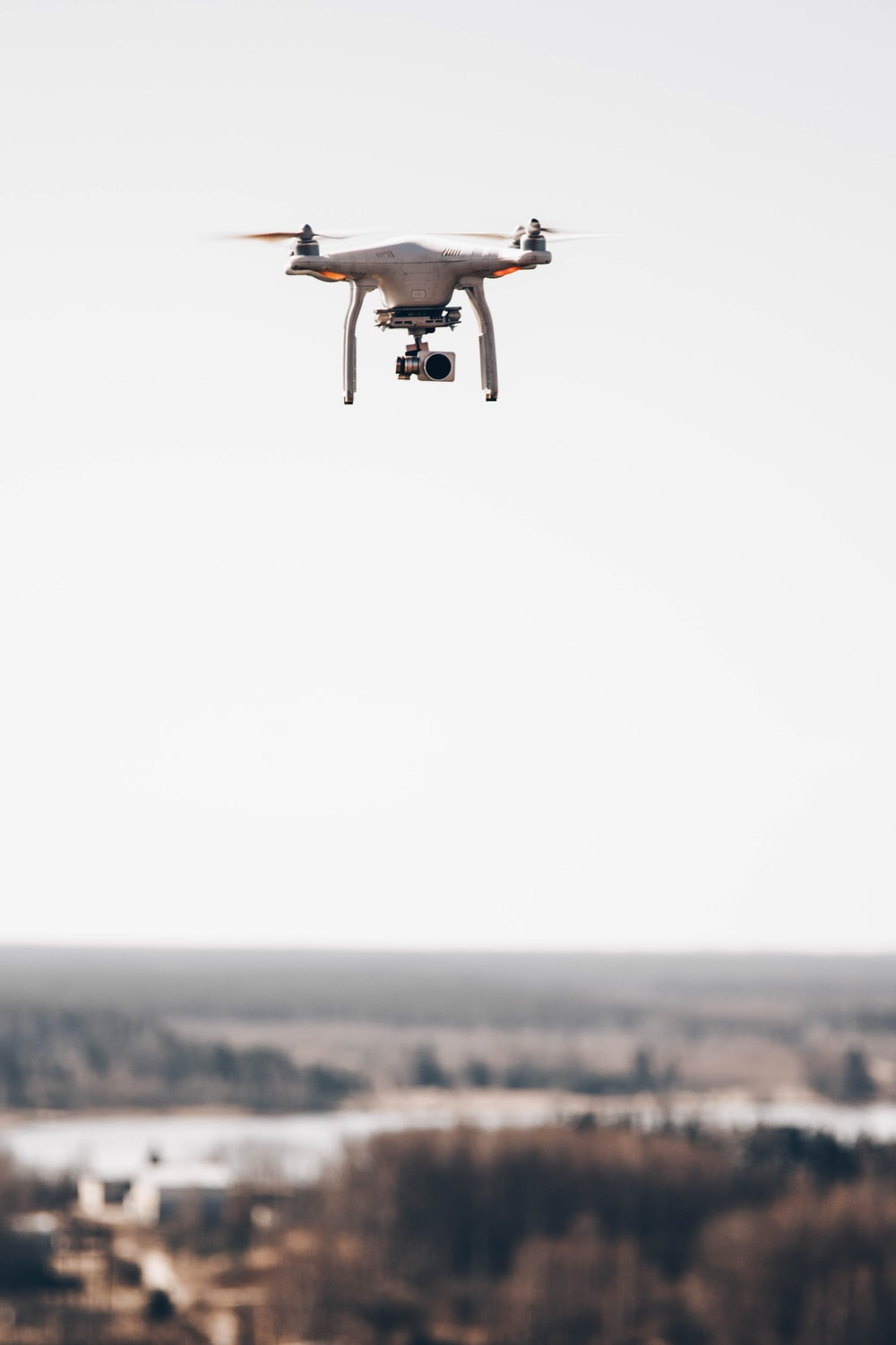 shallow focus photo of gray drone camera