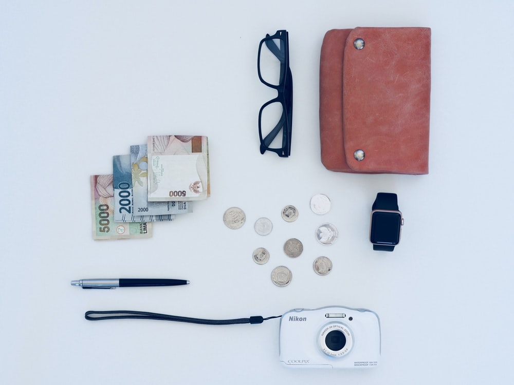 camera, pen, eyeglasses, watch, coin, and banknote