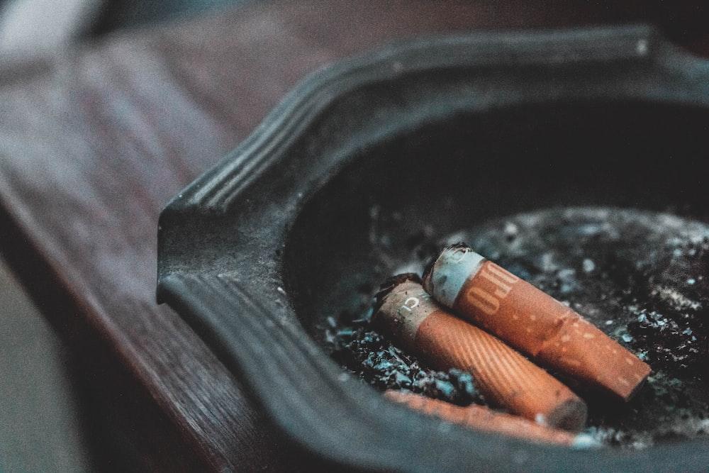 three cigarette butts on ashtray
