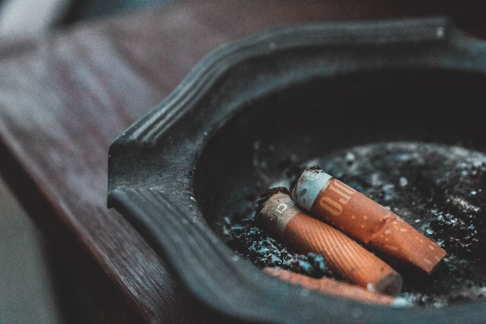 three cigarette butts on ashtray