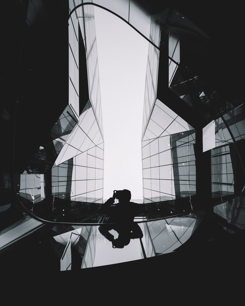 person in between the glass building