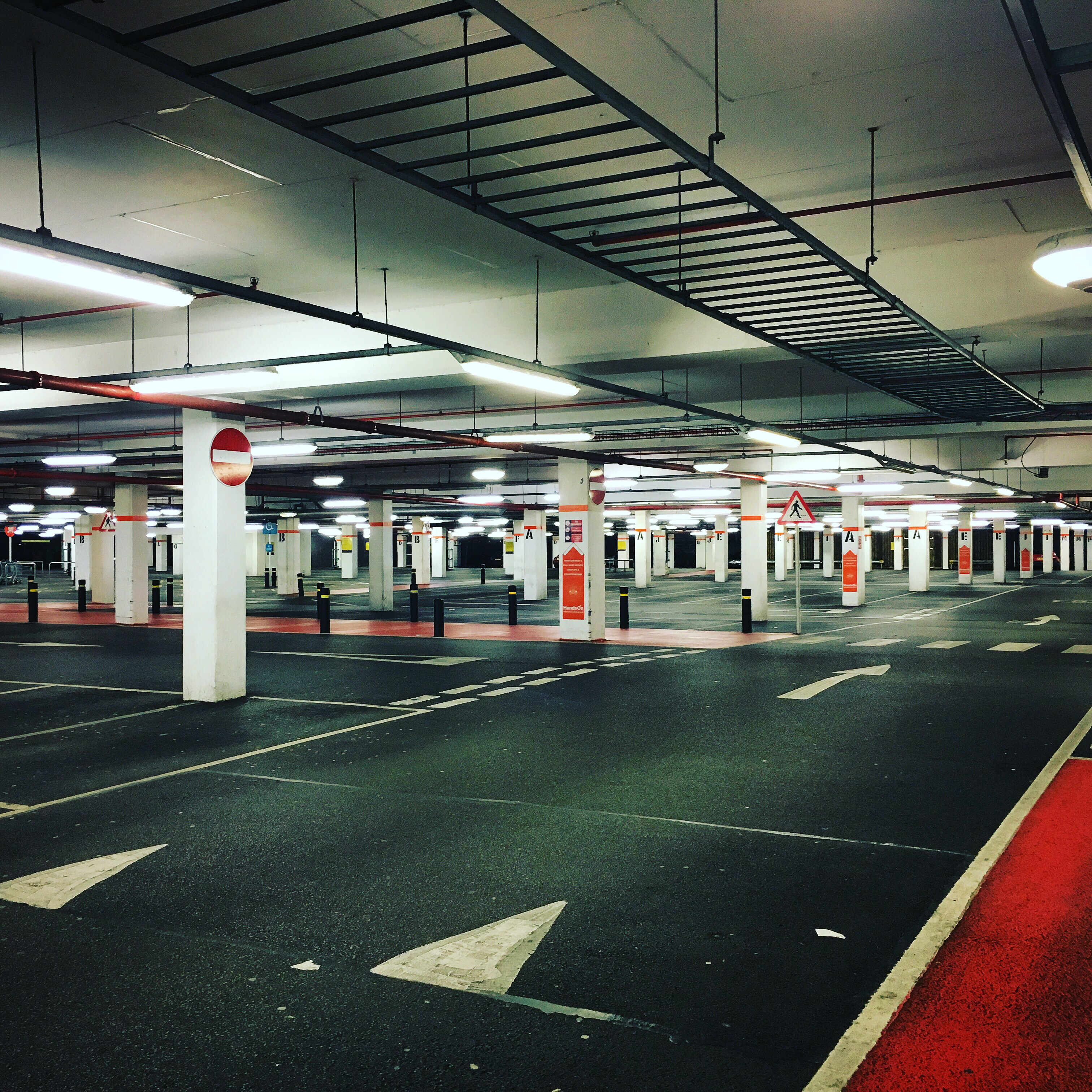 gray and white indoor parking lot