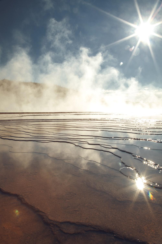 body of water under sunlight