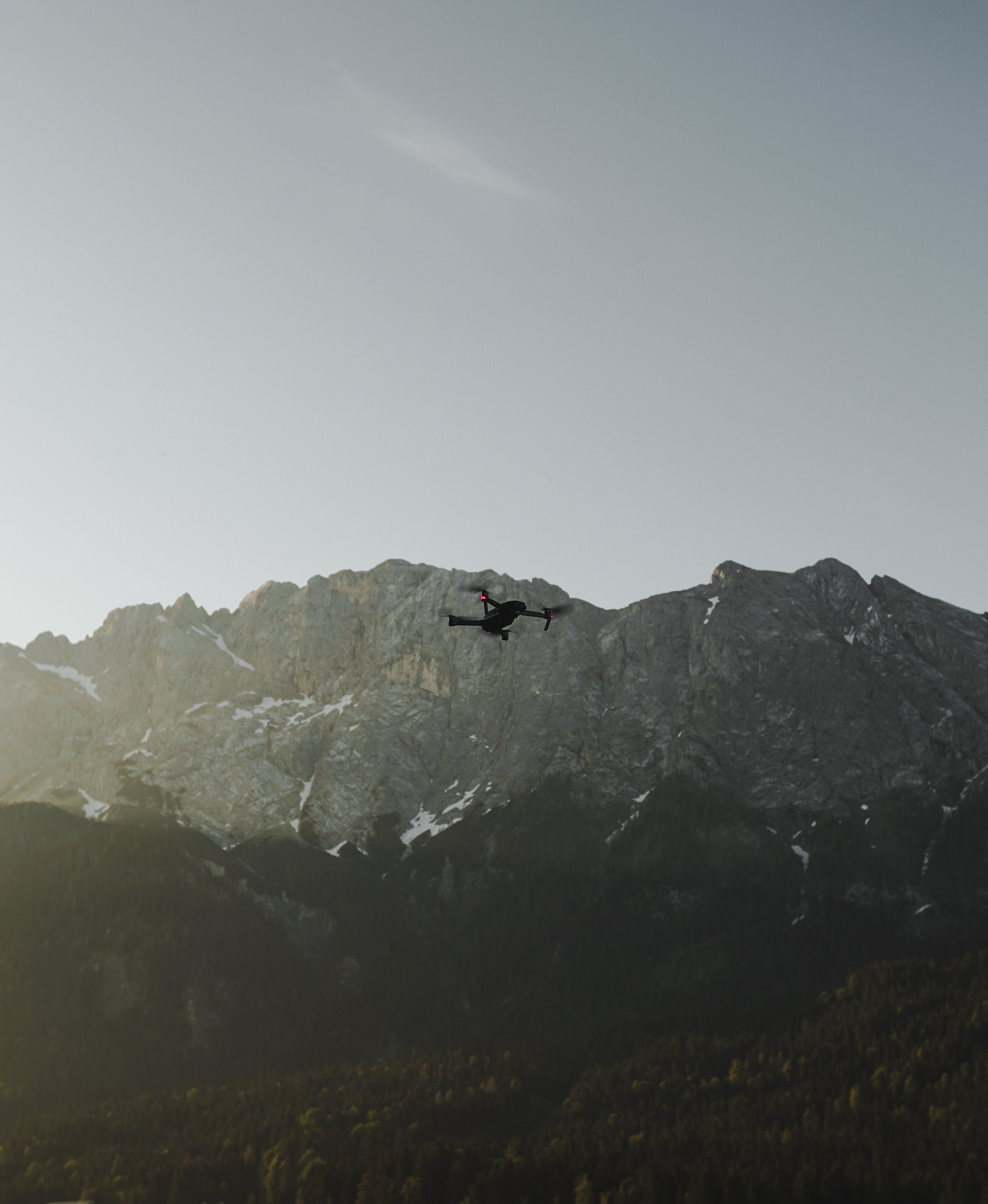 flaying black quad-copter drone