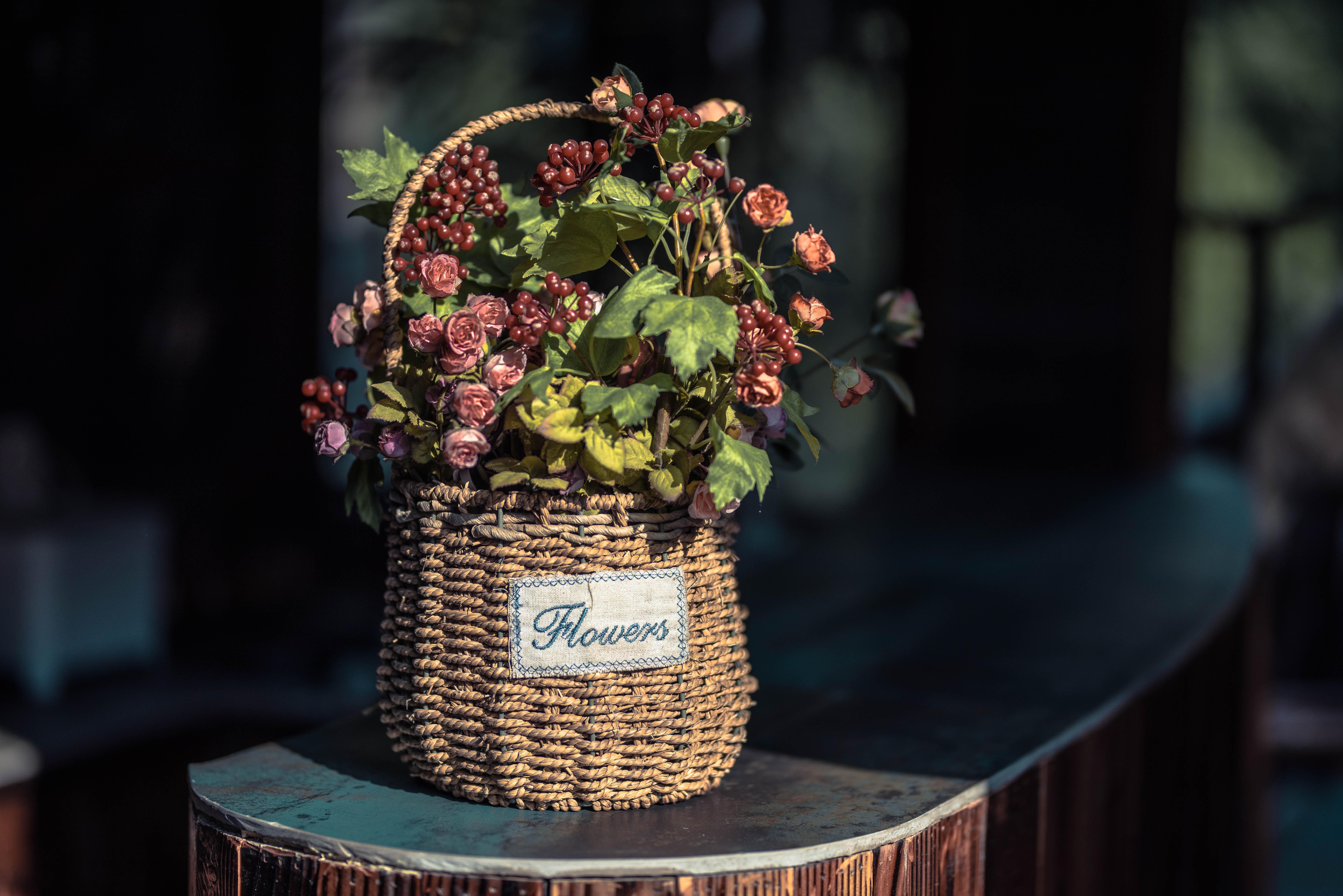 red flowers on brown wicker basket