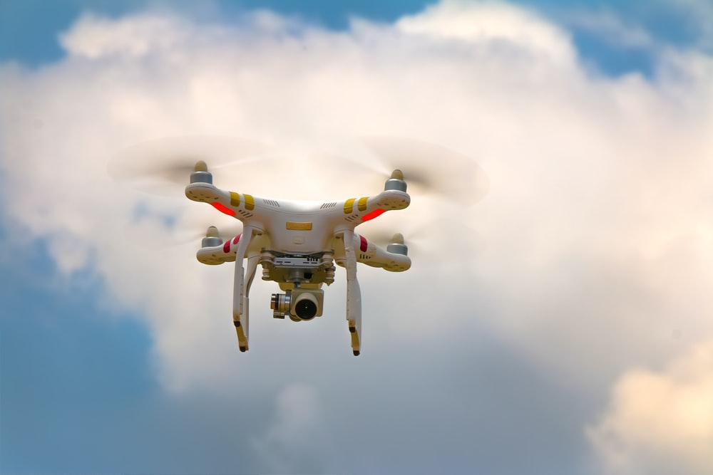 shallow focus photo of white drone camera