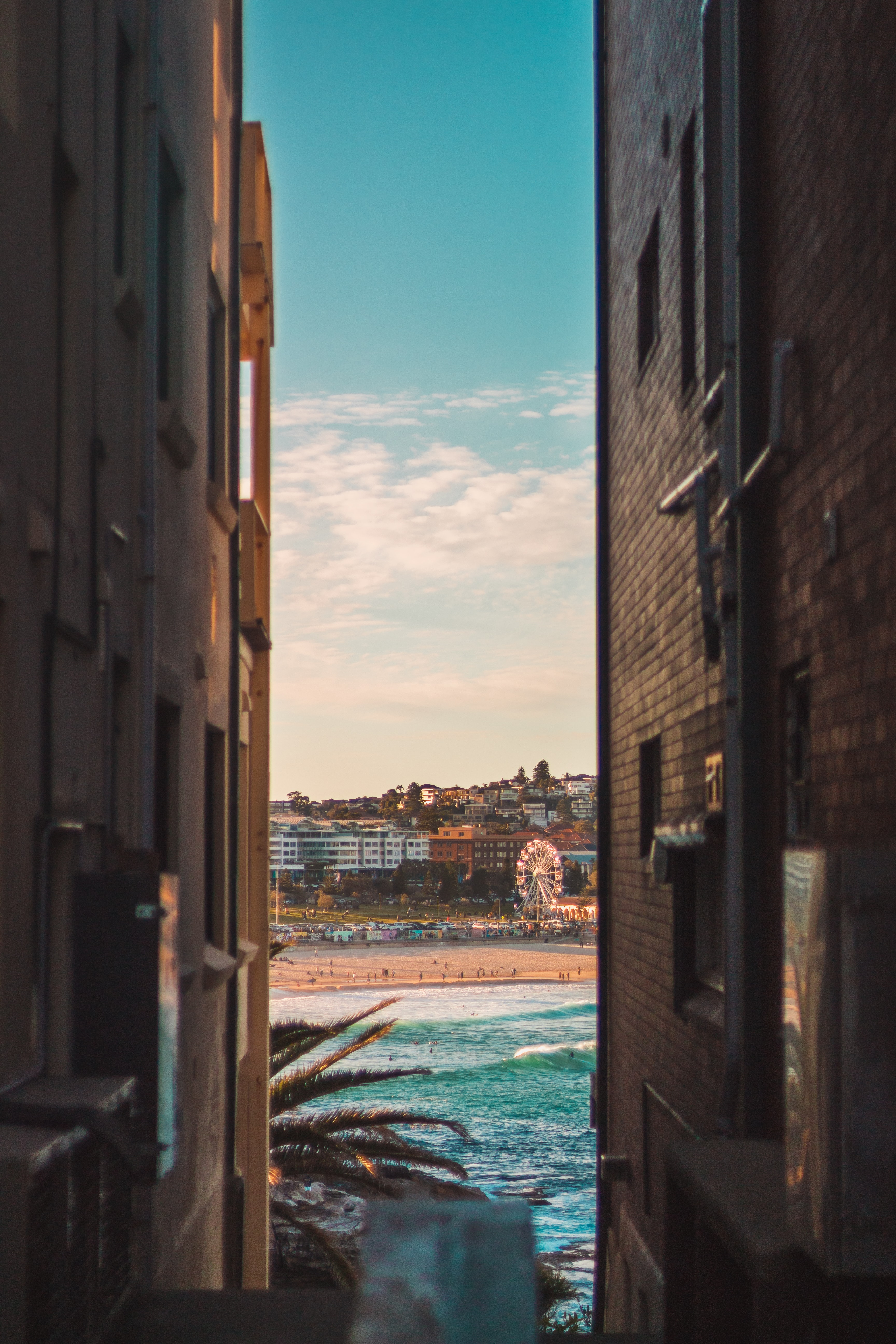 photography of water through narrow pathway at daytime