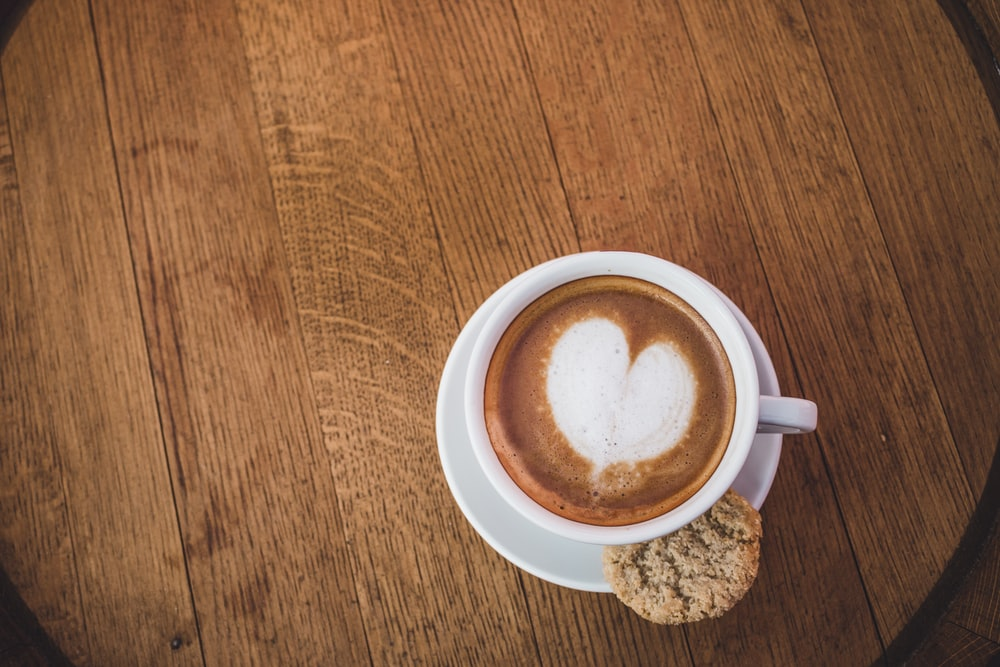 heart coffee art with cookie