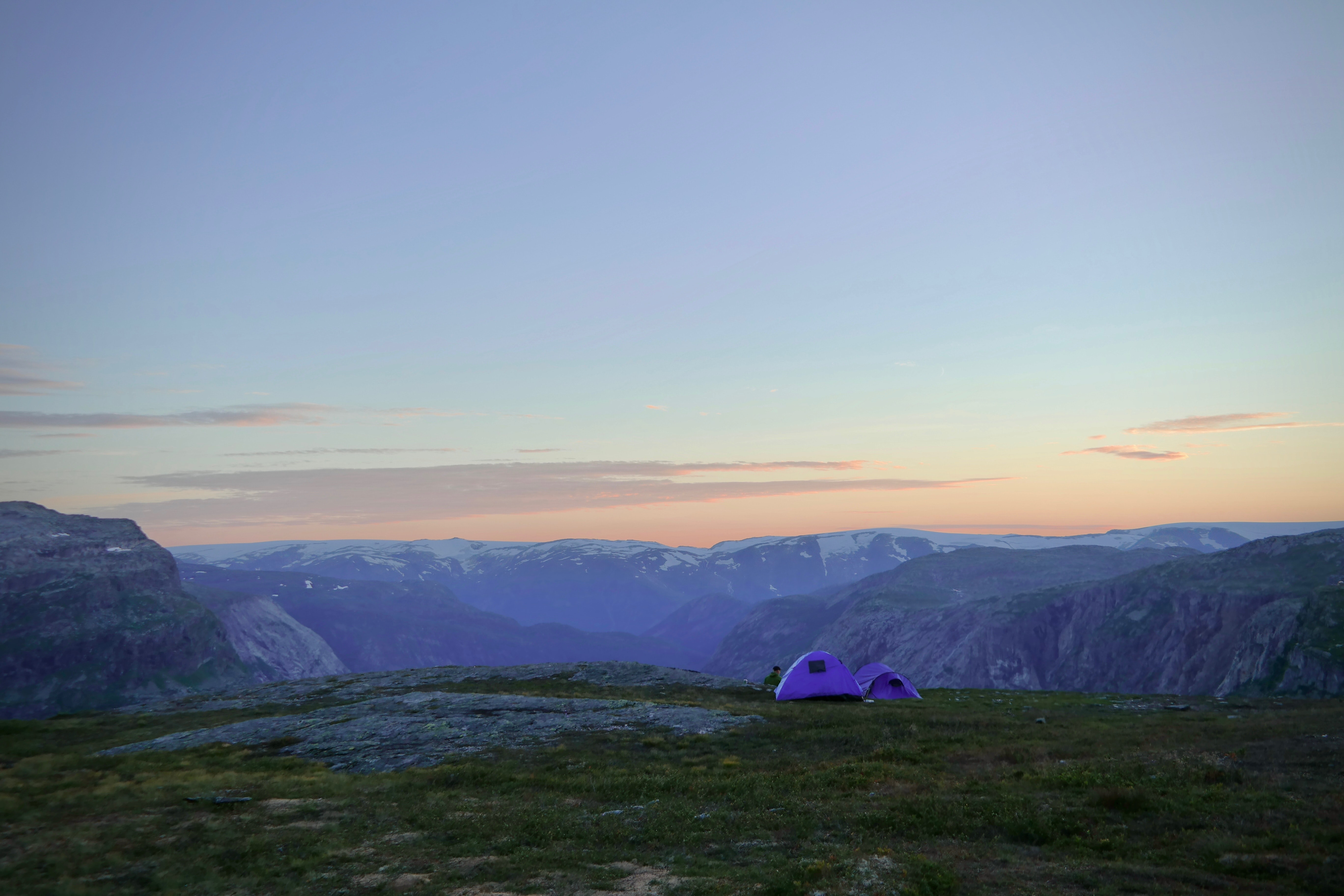 purple tent on hill at daytime