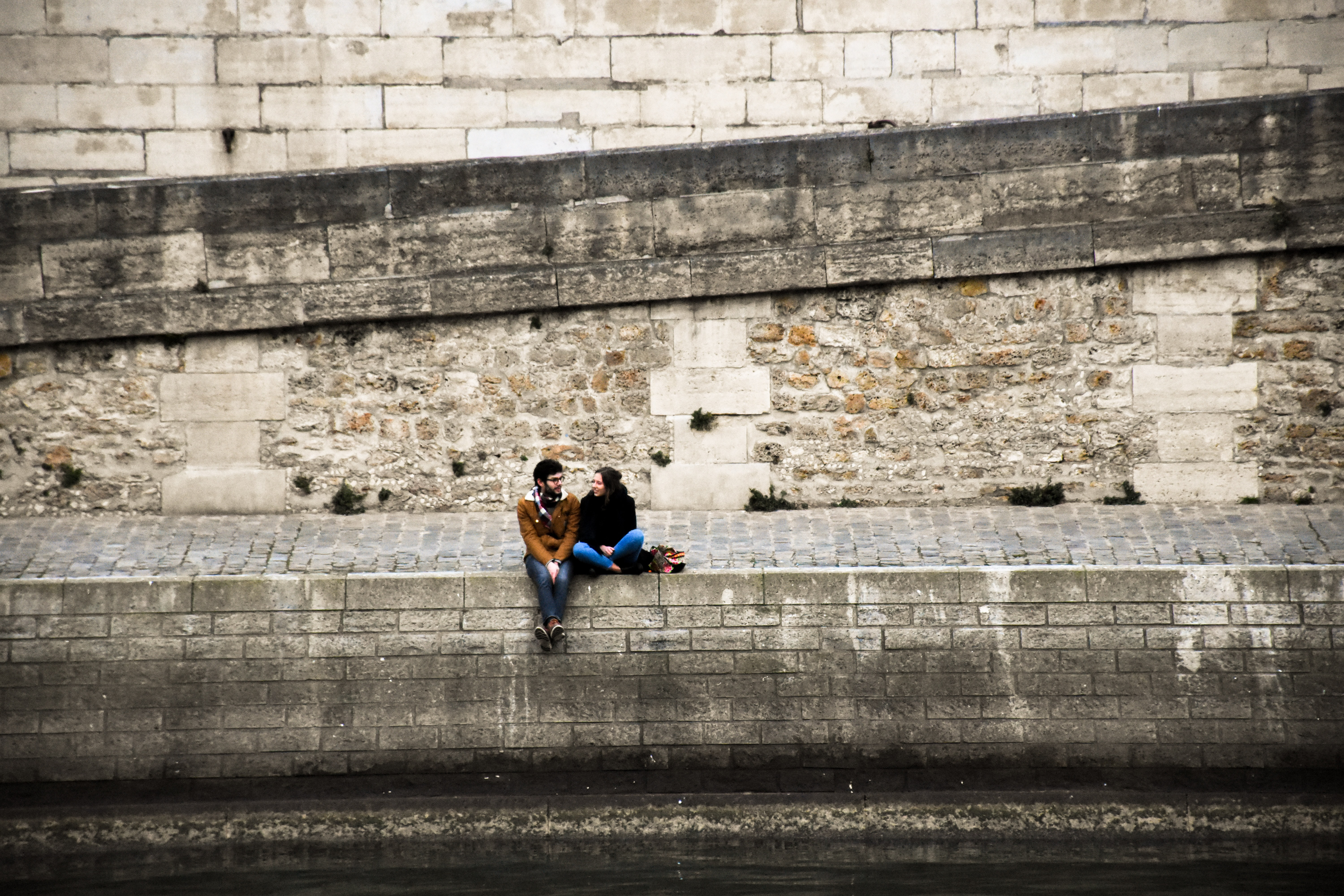 man and woman sitting together