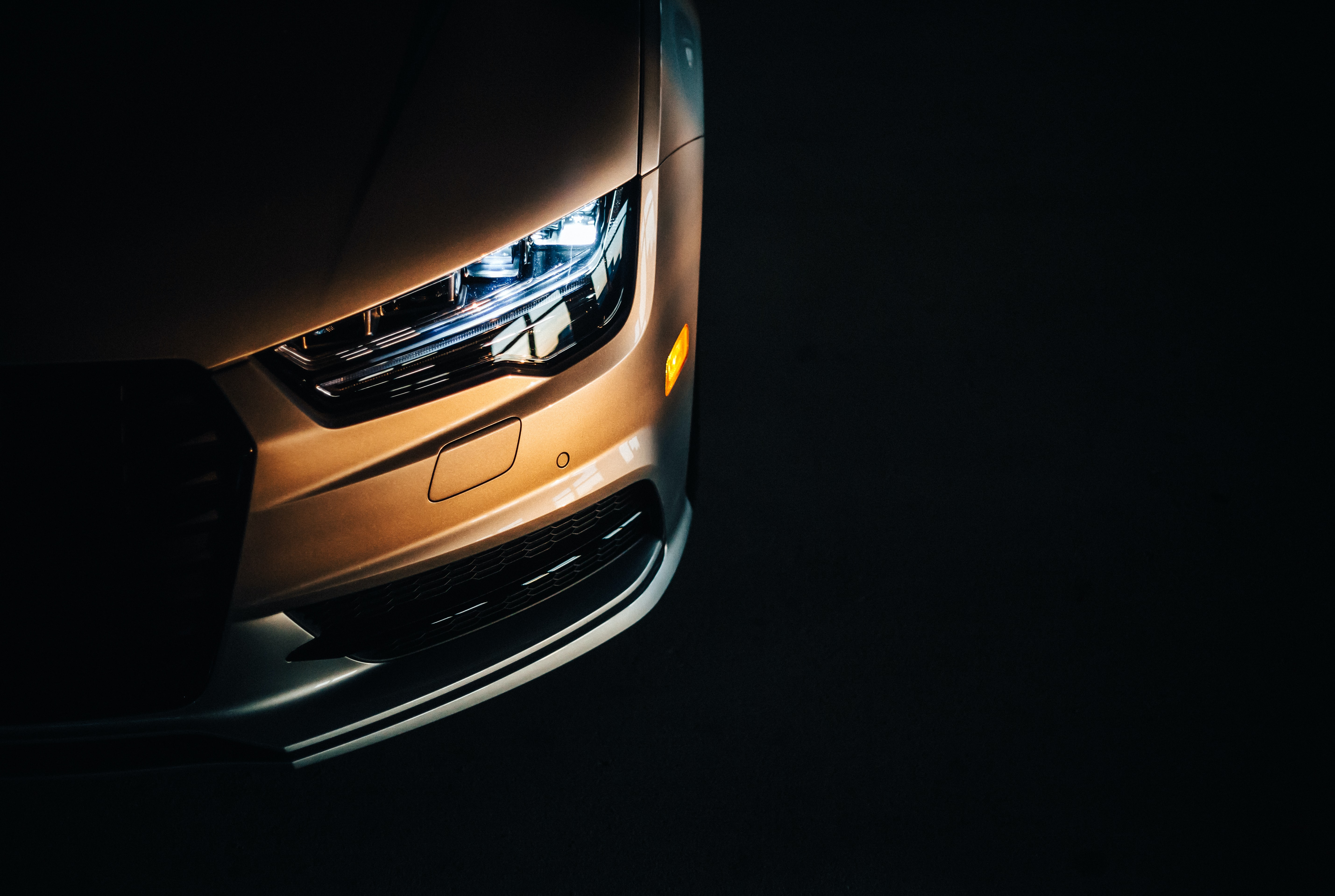 unpaired headlight with black background