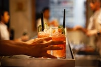 Refreshing drinks prepared by a mixologist and served in an upscale restaurant