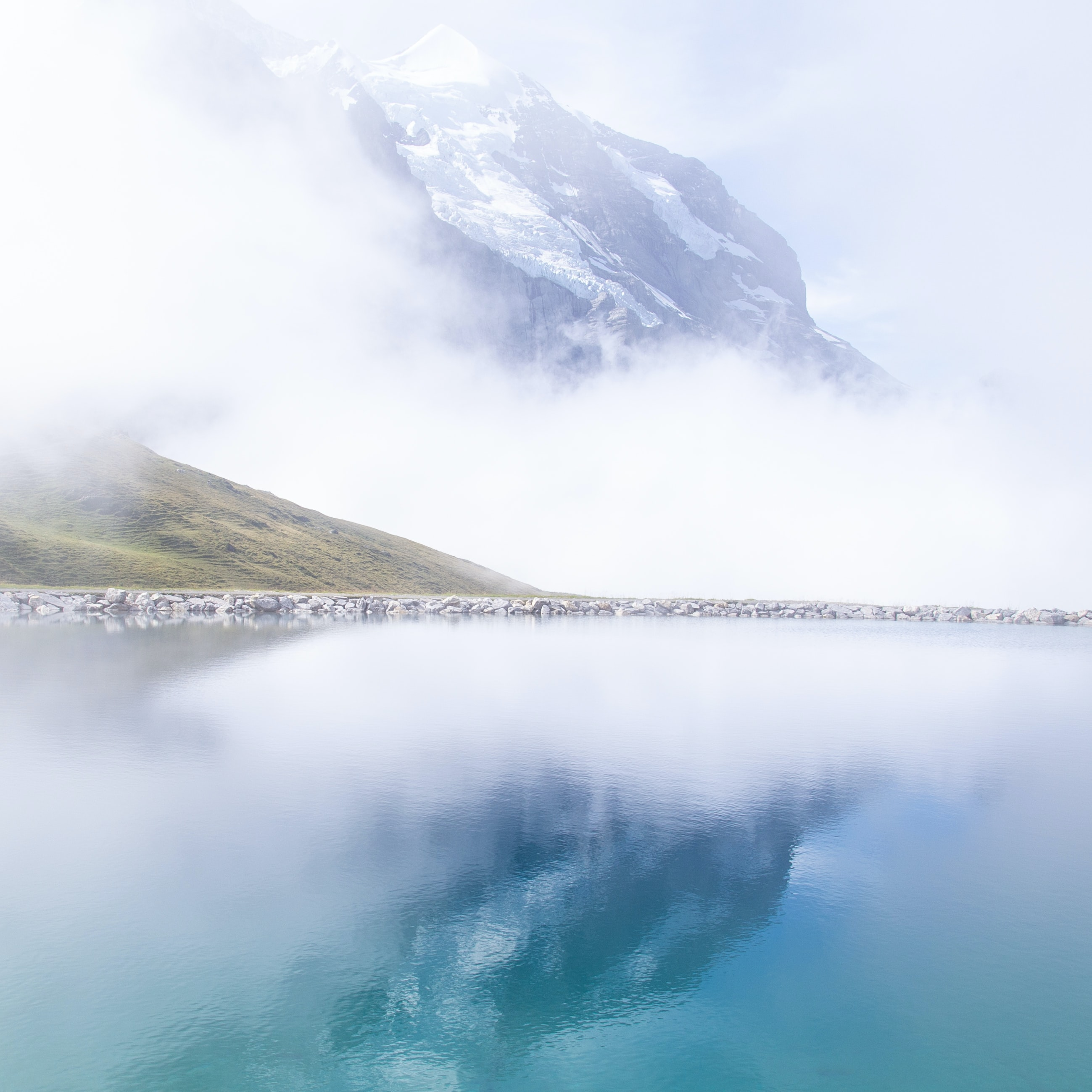 photography of glacier mountain with water reflection
