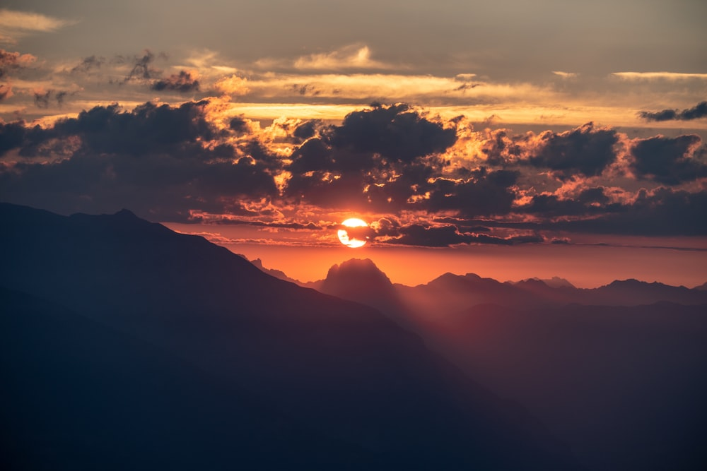 silhouette of mountain under sun