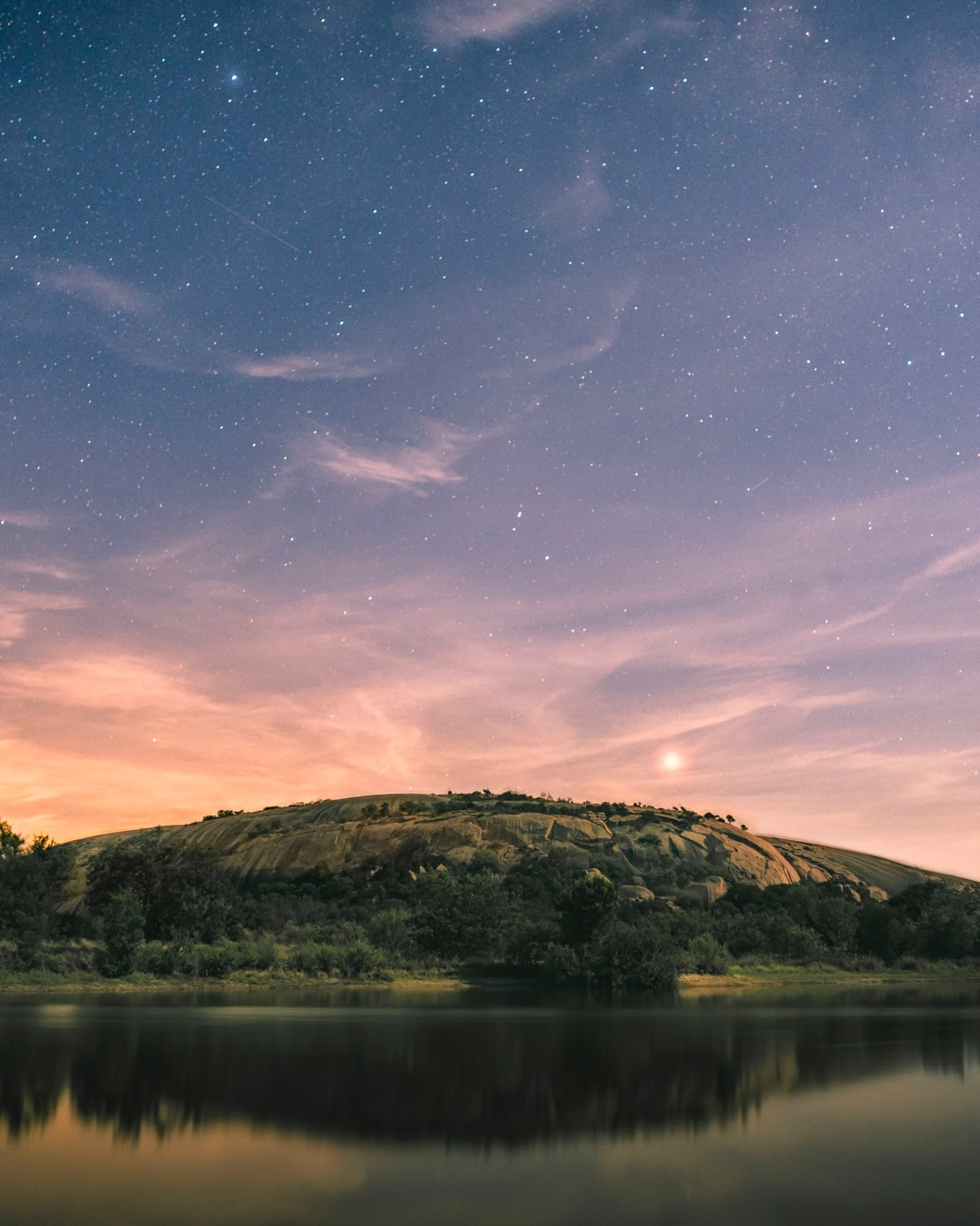 Full moon illuminated enchanted rock and clouds for an interesting long exposure