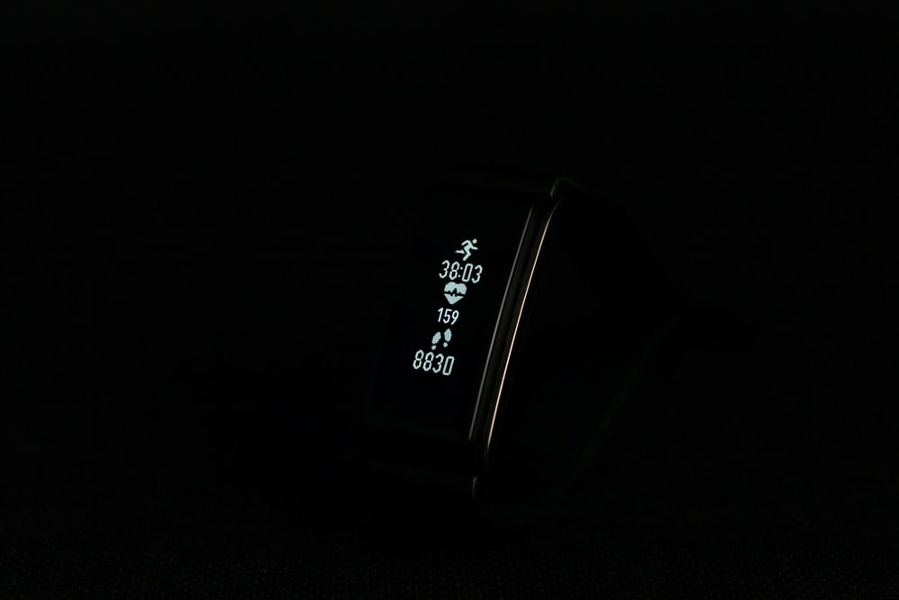 close-up photo of black fitness band powered on