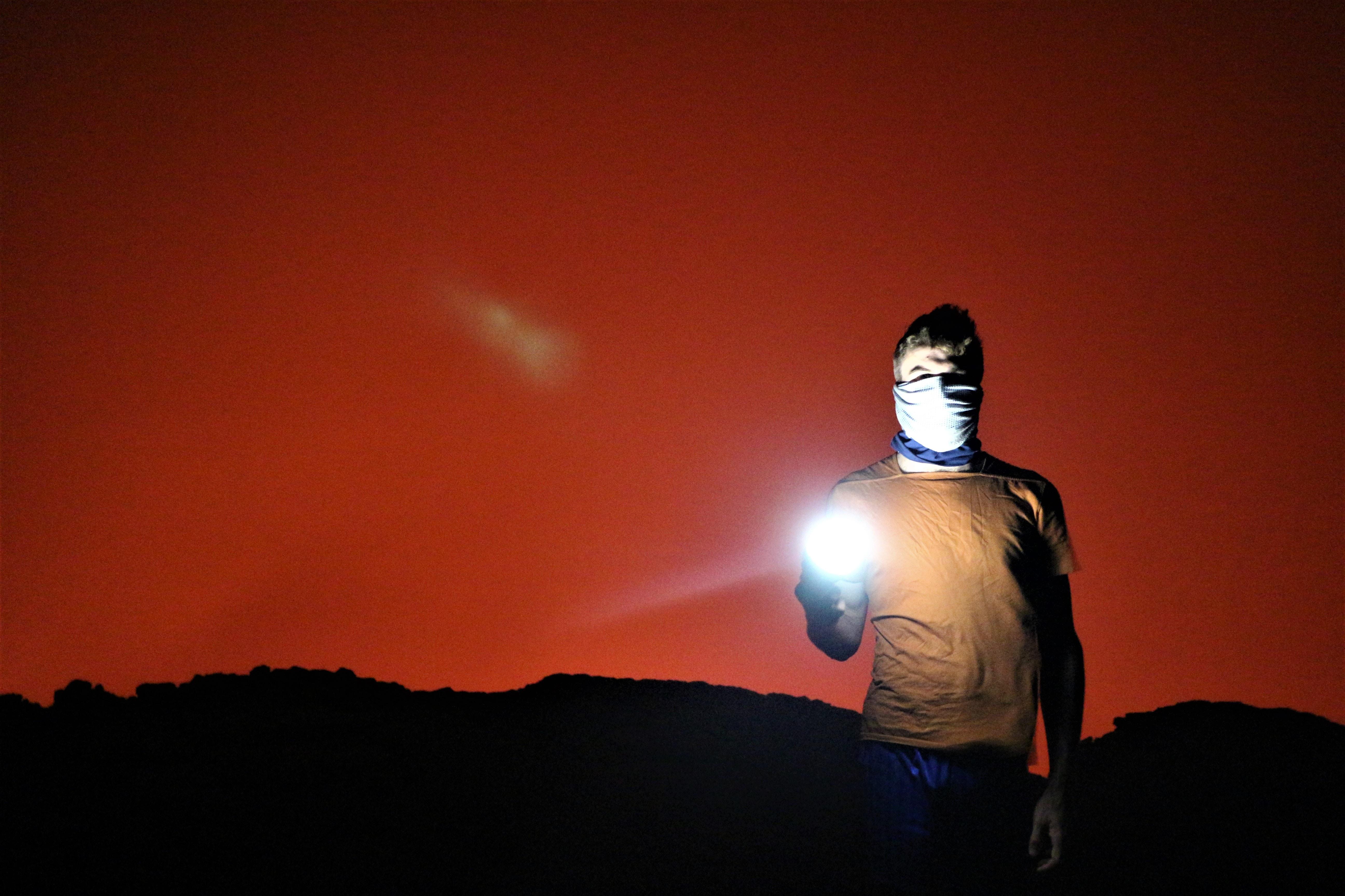 man holding flashlight