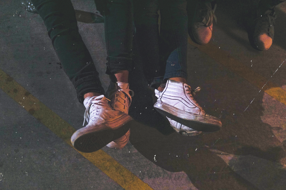two persons wearing high-top sneakers