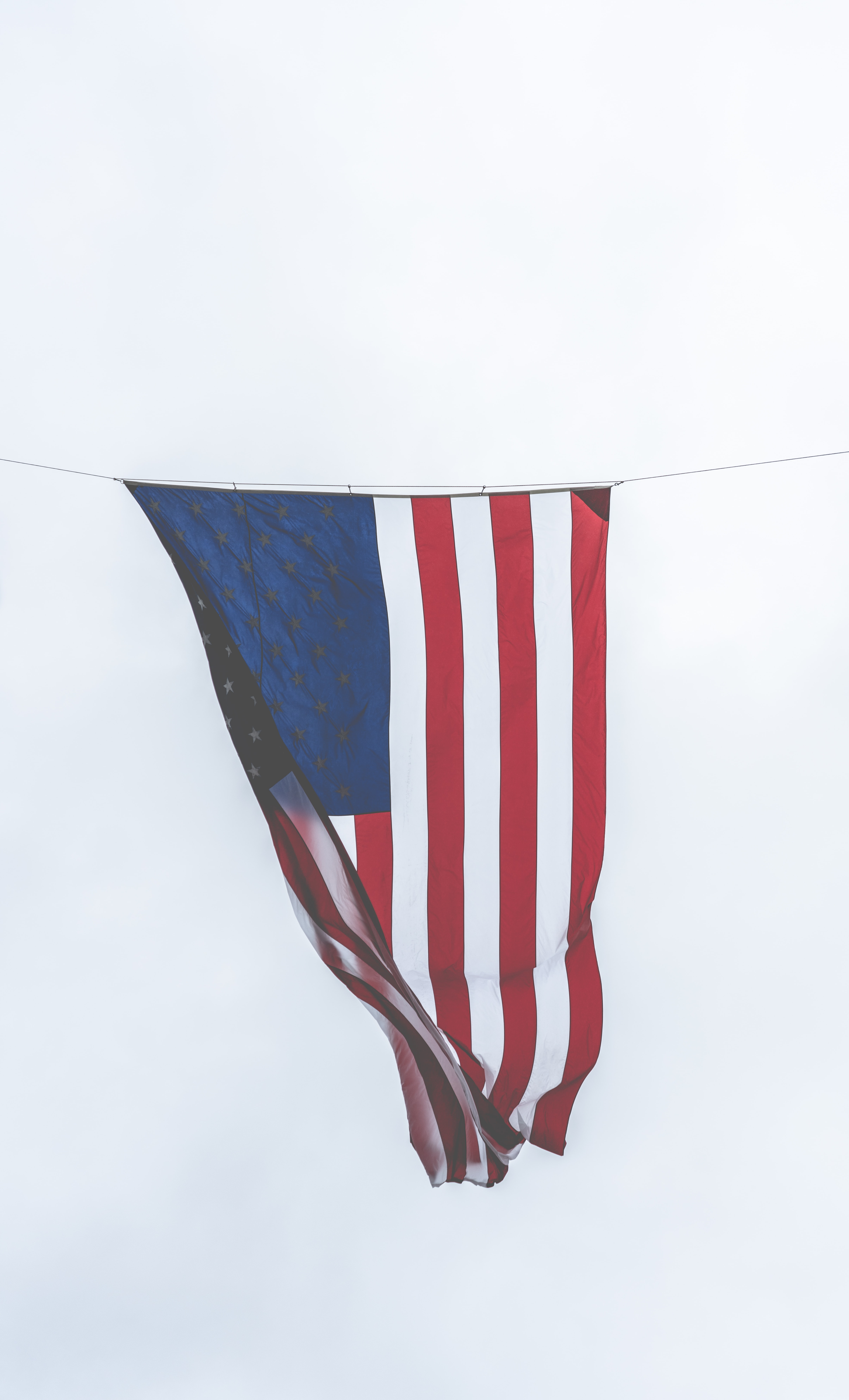 flag of USA hanged on string