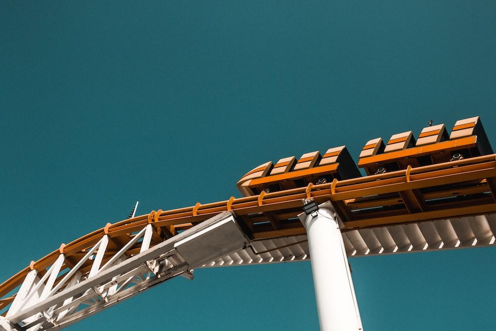 worm's-eye view of orange roller coaster