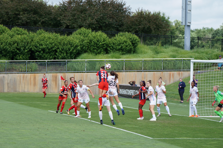 girls soccer team playing