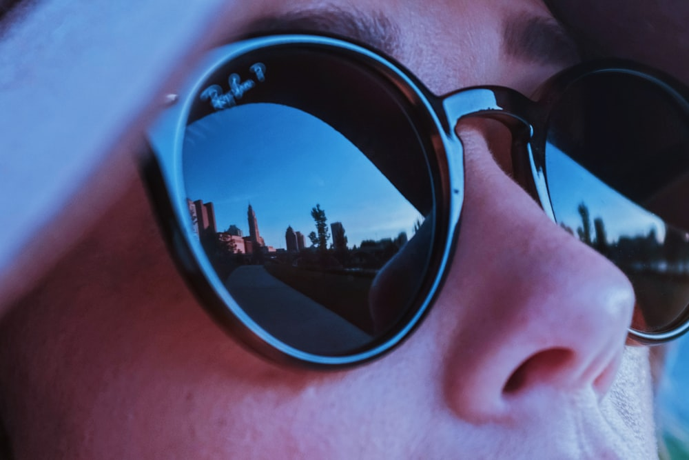 person wearing black Ray-Ban sunglasses