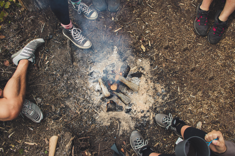 group of people surrounding bonefire