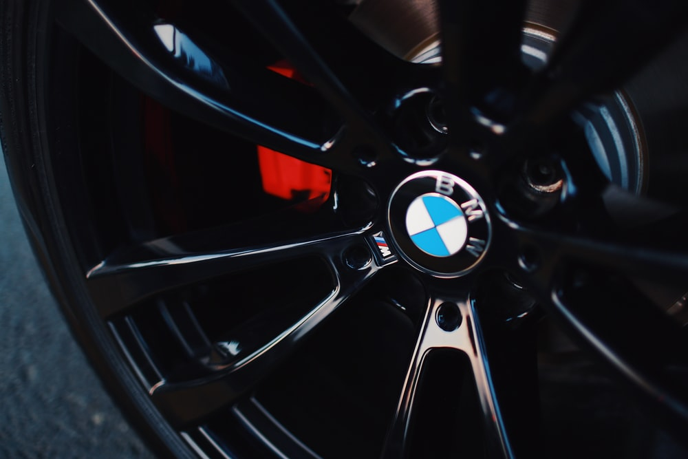 black BMW 5-spoke vehicle wheel with tire